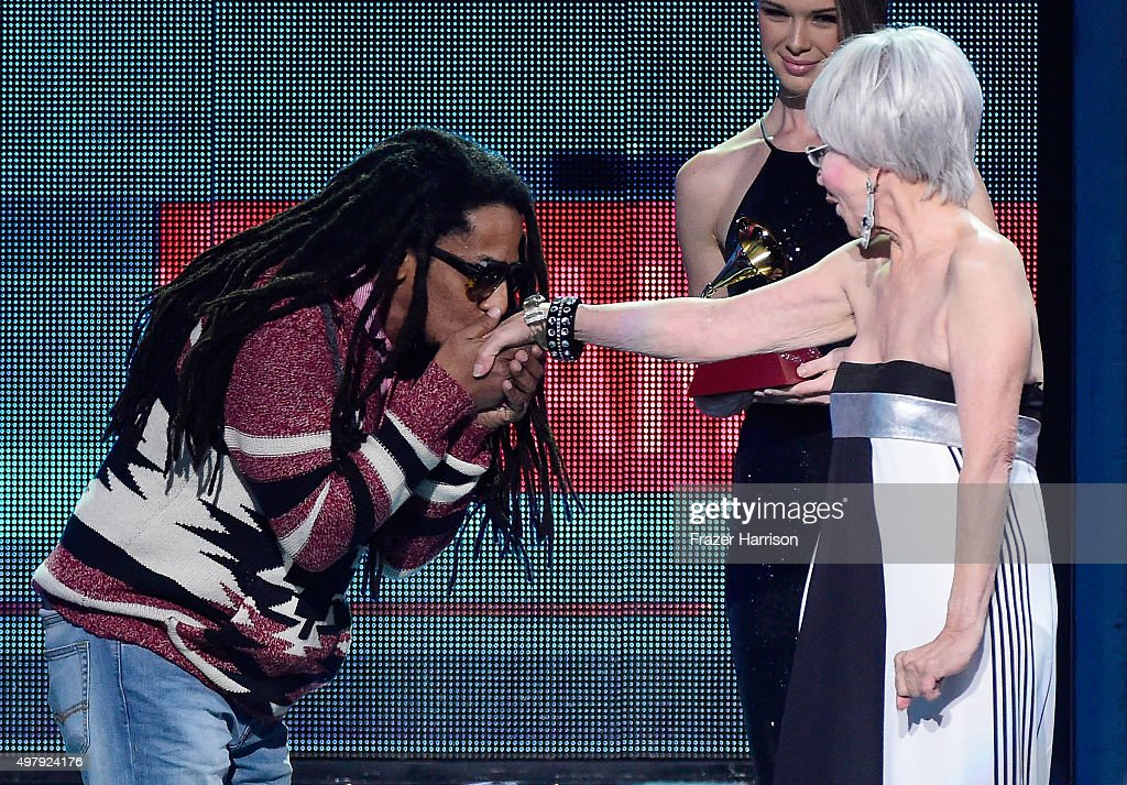 Actress Rita Moreno (R) presents recording artist Tego Calderon the Best Urban Music Album award for 'El Que Sabe, Sabe' onstage during the 16th Latin GRAMMY Awards at the MGM Grand Garden Arena on November 19, 2015 in Las Vegas, Nevada.