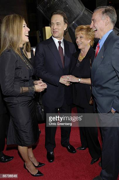Actress Rita Wilson and her husband actor Tom Hanks share a laugh with Dot Cunningham and her husband Apollo 7 astronaut Walter Cunningham in front...