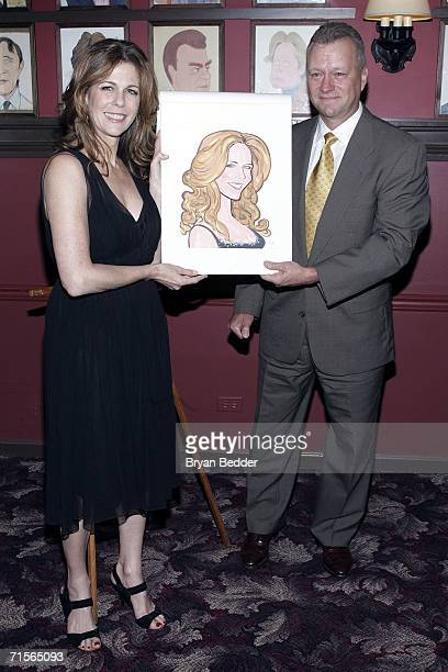 Actress Rita Wilson and owner of Sardi's restaurant Max Klimauicius pose with a caricature made in her honor for her Broadway debut in 'Chicago' on...