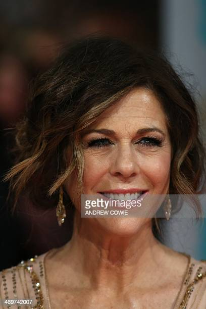 Actress Rita Wilson arrives on the red carpet for the BAFTA British Academy Film Awards at the Royal Opera House in London on February 16, 2014. AFP...