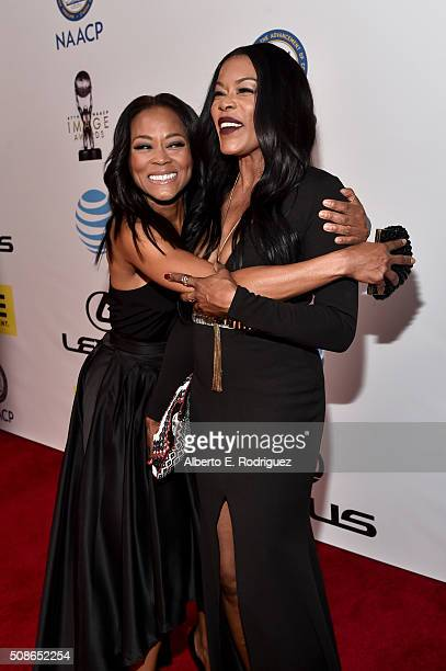 Actress Robin Givens and TV personality Golden Brooks attend the 47th NAACP Image Awards presented by TV One at Pasadena Civic Auditorium on February...