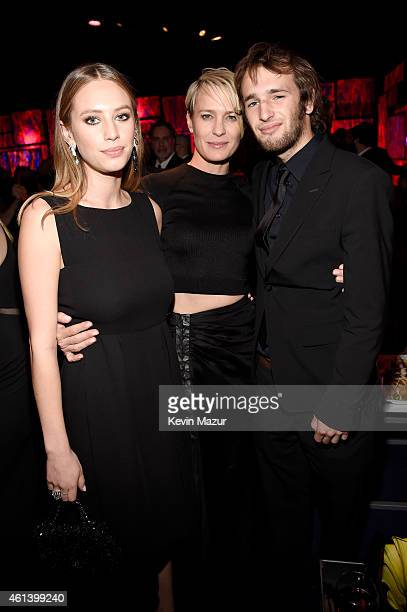 Actress Robin Wright and children Dylan Penn and Hopper Penn attend the 2015 InStyle And Warner Bros 72nd Annual Golden Globe Awards PostParty at The...