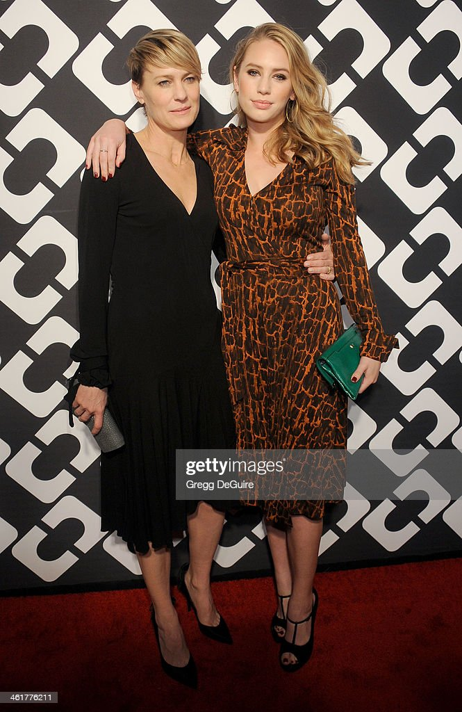 Actress Robin Wright and daughter Dylan Penn arrive at Diane Von Furstenberg's 'Journey Of A Dress' premiere opening party at Wilshire May Company Building on January 10, 2014 in Los Angeles, California.