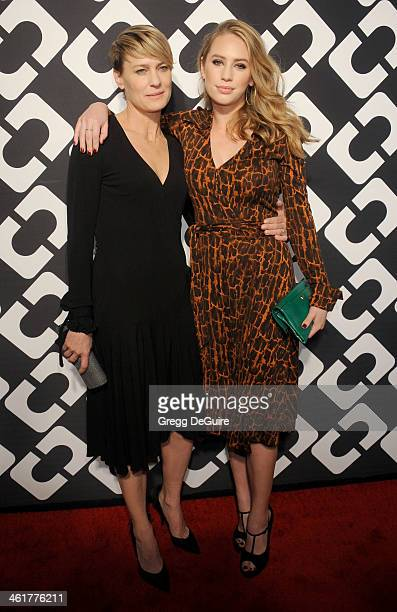 Actress Robin Wright and daughter Dylan Penn arrive at Diane Von Furstenberg's Journey Of A Dress premiere opening party at Wilshire May Company...