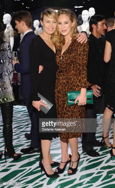 Actress Robin Wright and Dylan Penn both wearing Diane Von Furstenberg attend Diane Von Furstenberg's Journey of A Dress Exhibition Opening...