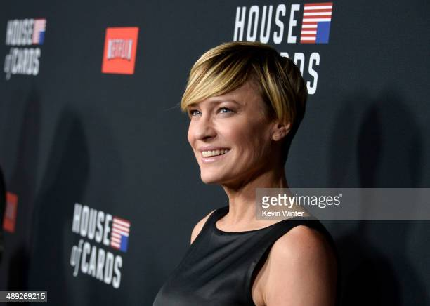 "Actress Robin Wright arrives at the special screening of Netflix's ""House of Cards"" Season 2 at the Directors Guild Of America on February 13, 2014..."