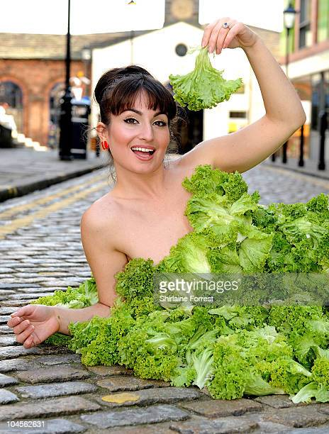 Actress Rokhsaneh GhawamShahidi wears a dress made entirely of lettuce leaves to encourage people to go vegan in aid of PETA at Leeds Corn Exchange...