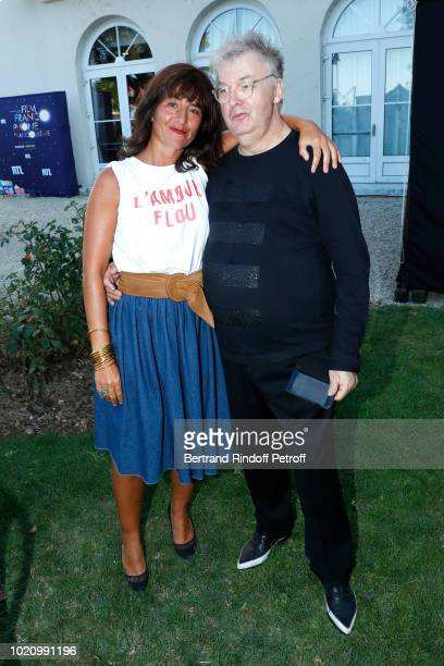 Actress Romane Bohringer and Cocreator of the Festival Dominique Besnehard attend the 11th Angouleme FrenchSpeaking Film Festival Day One on August...