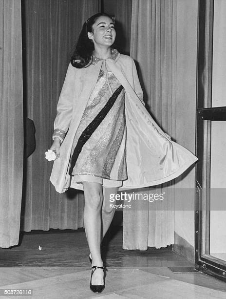 Actress Romina Power daughter of famous actor Tyrone Power wearing an original petticoat dress as she arrives at the gala performance of the play 'La...