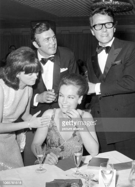 Actress Romy Schneider and her husband Harry Meyen talks to former boxer Bubi Scholz and his wife Helga during the International Film Festival on the...