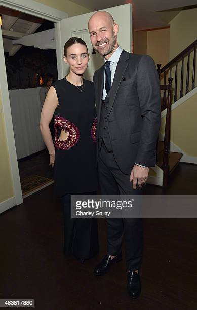 Actress Rooney Mara and publisher of Vanity Fair Chris Mitchell attend VANITY FAIR and Barneys New York Dinner benefiting OXFAM hosted by Rooney Mara...