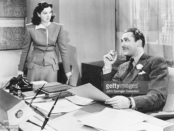 Actress Rosalind Russell as secretary Kendal Browning and actor Brian Aherne as advertising executive Stephen Dexter in the 1940 comedy Hired Wife In...