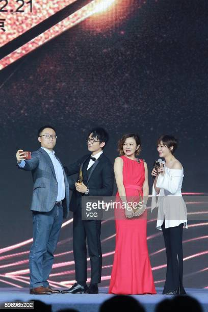 Actress Rosamund Kwan poses with trophy for a photo during the 2017 Donews Award Ceremony on December 21 2017 in Beijing China