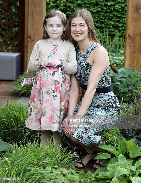Actress Rosamund Pike and 7 year old cystic fibrosis sufferer Ava Watt at the Morgan Stanley Garden for Great Ormond Street Hospital at the...
