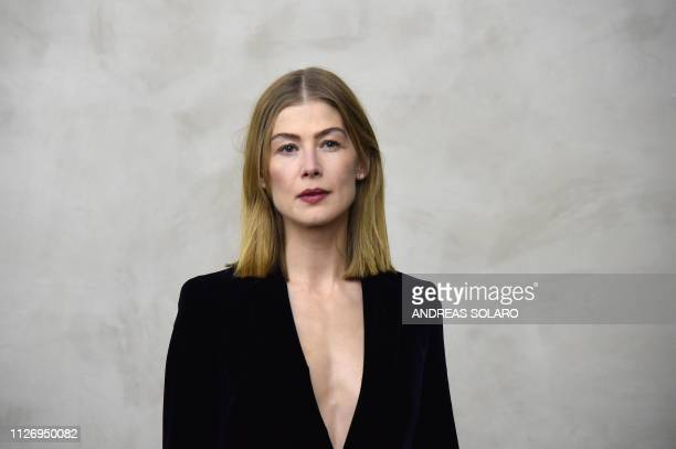 Actress Rosamund Pike attends the Giorgio Armani women's Fall/Winter 2019/2020 collection fashion show, on February 23, 2019 in Milan.