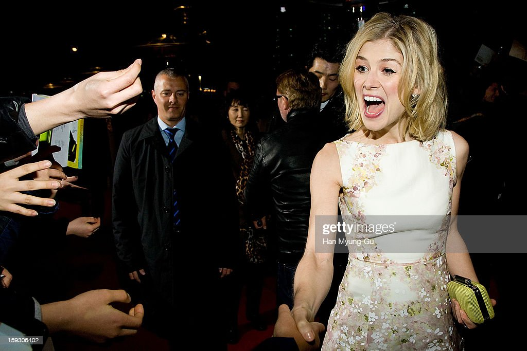 Actress Rosamund Pike poses with fans as he arrives at the 'Jack Reacher' Fan Screening at Busan Cinema Center on January 10, 2013 in Busan, South Korea. The film will open on January 17 in South Korea.