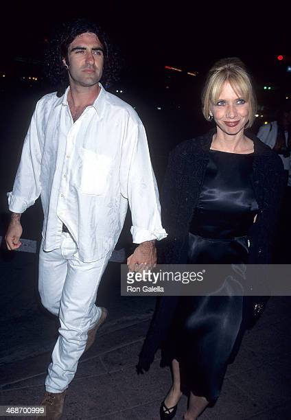 Actress Rosanna Arquette and husband John Sidel attend the Desperado Westwood Premiere on August 21 1995 at the Mann National Theatre in Westwood...