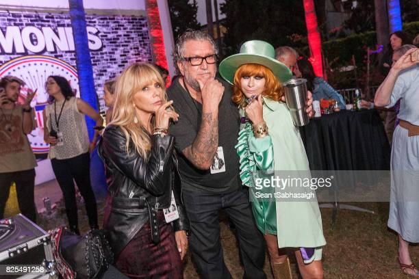 Actress Rosanna Arquette musician Steve Jones and Linda Ramone speak to thousands of Ramones fans in attendance at the 2017 Johnny Ramone tribute and...
