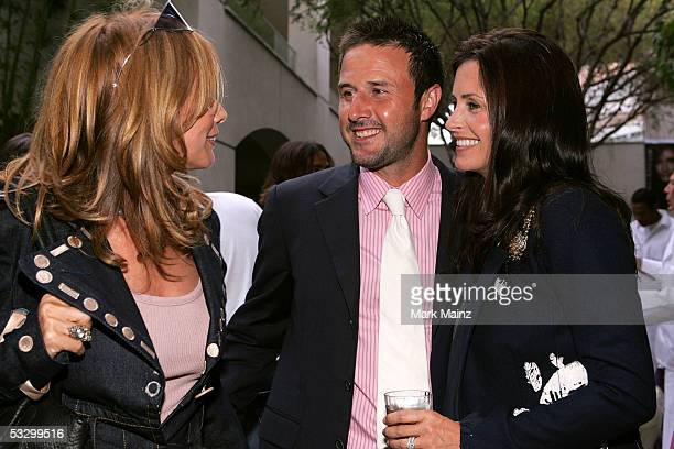 Actress Rosanna Arquette talks to her brother actor David Arquette and his wife actress Courteney Cox at the EB Medical Research Foundation...
