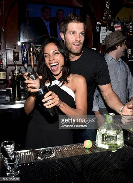 Actress Rosario Dawson and actor Geoff Stults work behind the bar at Geoff Stults' birthday party fundraiser to benefit The Charlotte and Gwenyth...