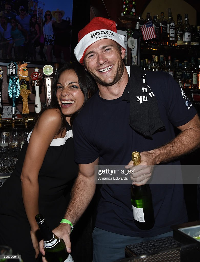 Actress Rosario Dawson (L) and actor Scott Eastwood work behind the bar at Geoff Stults' birthday party fundraiser to benefit The Charlotte and Gwenyth Gray Foundation at Rock and Reilly's Irish Pub on December 9, 2015 in West Hollywood, California.