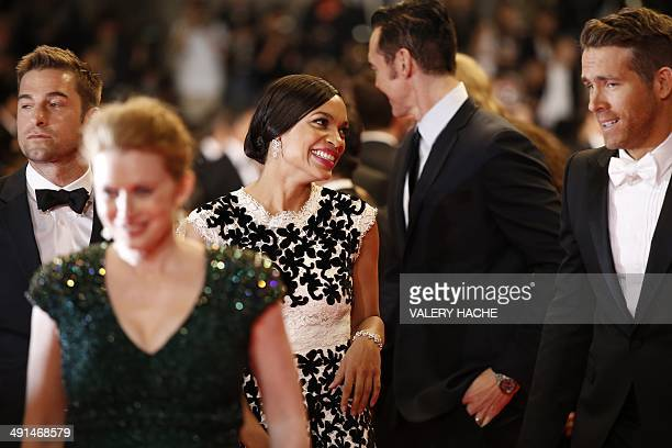 """Actress Rosario Dawson and Canadian actor Ryan Reynolds arrive for the screening of the film """"Captives"""" at the 67th edition of the Cannes Film..."""