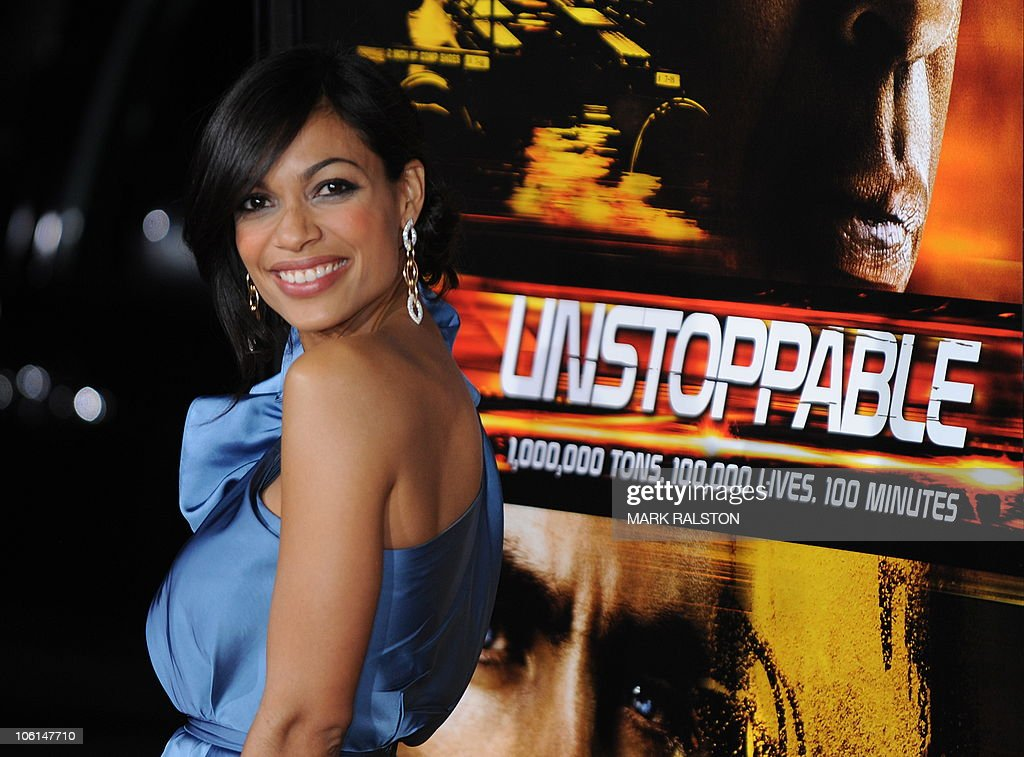 Actress Rosario Dawson arrives on the red carpet for the premiere of the film 'Unstoppable' in which she plays a lead role, at the Regency Village Theater in Los Angeles on October 26, 2010. AFP PHOTO/Mark RALSTON