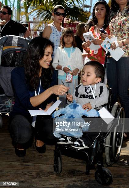 Actress Rosario Dawson attends the MakeAWish Foundation's Day of Fun hosted by Kevin Steffiana James held at Santa Monica Pier on March 14 2010 in...