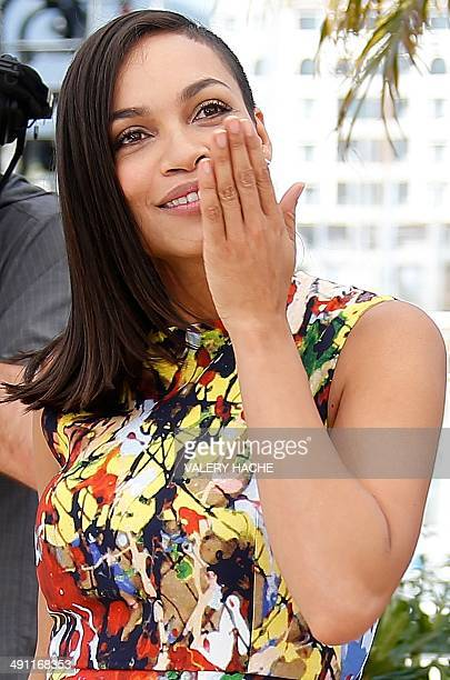 US actress Rosario Dawson blows kisses while posing during a photocall for the film 'Captives' at the 67th edition of the Cannes Film Festival in...