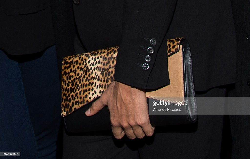 Actress Rosario Dawson, clutch detail, attends Geoff Stults' birthday party fundraiser to benefit The Charlotte and Gwenyth Gray Foundation at Rock and Reilly's Irish Pub on December 9, 2015 in West Hollywood, California.
