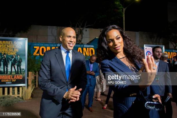 US actress Rosario Dawson takes a picture with boyfriend US Senator Cory Booker at the red carpet of the world premiere of Zombieland Double Tap at...