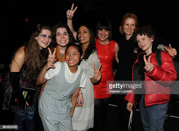 Actress Rosario Dawson writer Eve Ensler actress Cynthia Nixon and her daughter Samantha Mozes pose with cast members at the VDay benefit reading of...