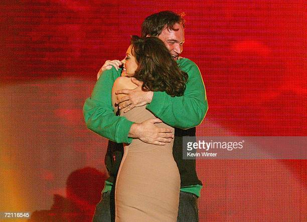 Actress Rose McGowan and Director Quentin Tarantino onstage during Spike TV's Scream Awards 2006 at the Pantages Theatre on October 7 2006 in Los...