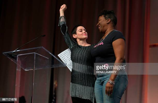 US actress Rose McGowan and Founder of #MeToo Campaign Tarana Burke embrace on stage at the Women's March / Women's Convention in Detroit Michigan on...