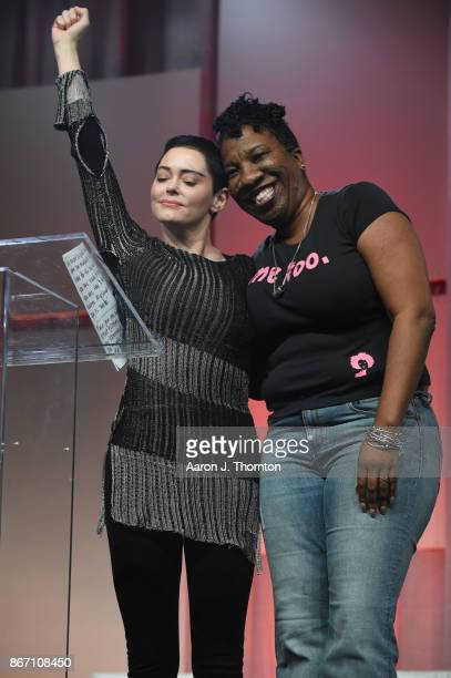 Actress Rose McGowan and Tarana Burke on stage at The Women's Convention at Cobo Center on October 27 2017 in Detroit Michigan