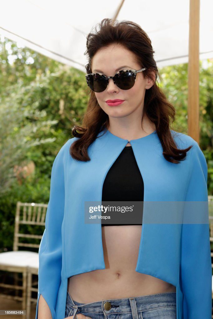 Actress Rose McGowan attends the 2013 CFDA/Vogue Fashion Fund Event Presented by thecorner.com and Supported by Audi, Living Proof, and MAC Cosmetics at the Chateau Marmont on October 23, 2013 in Los Angeles, California.