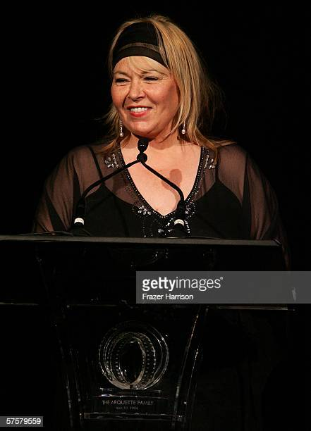 Actress Roseanne Barr introduces Alexis Arquette onstage at the AFI Associates luncheon honoring Hollywood's Arquette family with the 6th Annual...