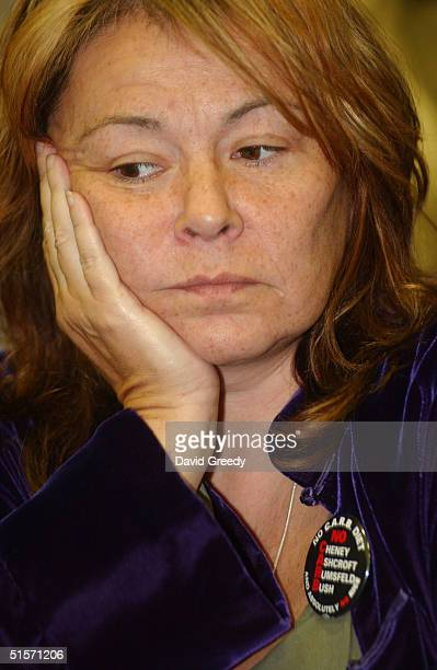 Actress Roseanne Barr talks at a new conference before taking the stage with filmmaker Michael Moore on his Slacker Uprising Tour October 25 2004 in...