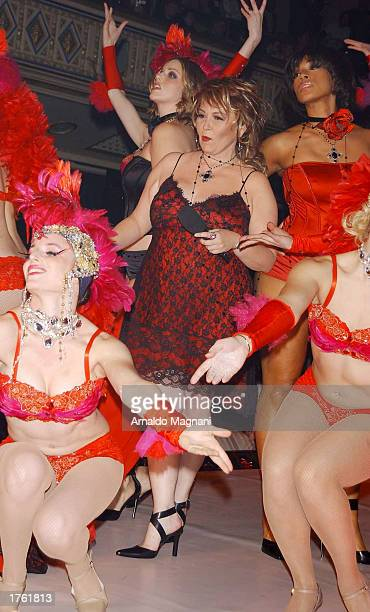 Actress Roseanne Barr walks on the runway during the Lane Bryant fashion show February 4 2003 at the Hammerstein Ballroom in New York City
