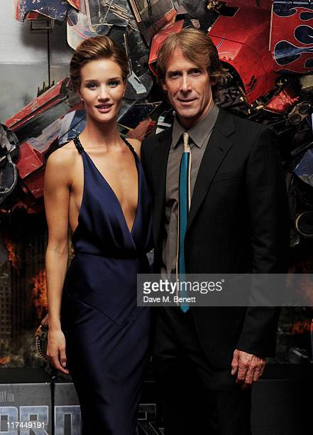 Actress Rosie HuntingtonWhiteley and director Michael Bay arrive at the UK Premiere of Transformers Dark Of The Moon at BFI IMAX on June 26 2011 in...