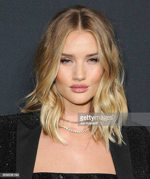 Actress Rosie HuntingtonWhiteley arrives at SAINT LAURENT At The Palladium at Hollywood Palladium on February 10 2016 in Los Angeles California