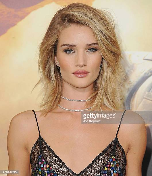 Actress Rosie HuntingtonWhiteley arrives at the Los Angeles Premiere Mad Max Fury Road at TCL Chinese Theatre IMAX on May 7 2015 in Hollywood...