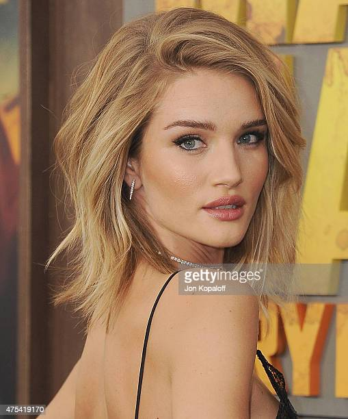 Actress Rosie HuntingtonWhiteley arrives at the Los Angeles Premiere 'Mad Max Fury Road' at TCL Chinese Theatre IMAX on May 7 2015 in Hollywood...