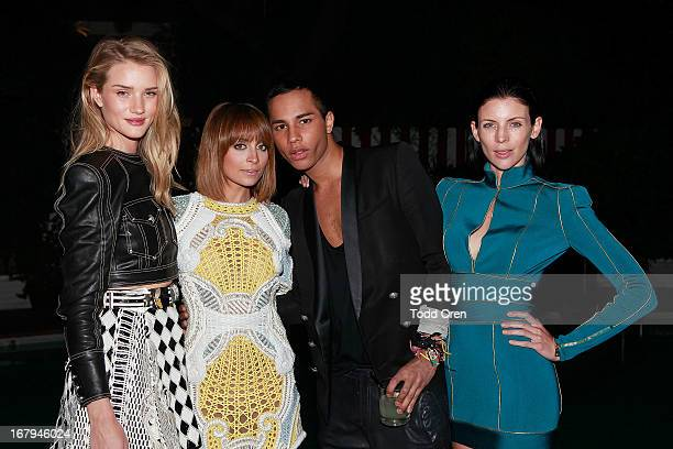 Actress Rosie HuntingtonWhiteley Nicole Richie Designer Olivier Rousteing Actress Liberty Ross attend the Balmain LA Dinner at Chateau Marmont on May...