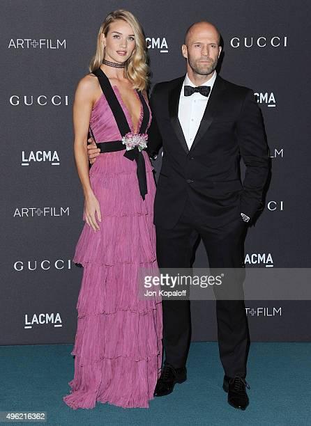 Actress Rosie HuntingtonWhiteley wearing Gucci and actor Jason Statham attend the LACMA Art Film Gala honoring Alejandro Gonzalez Iarritu and James...