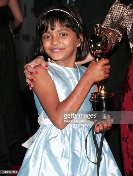 Actress Rubina Ali poses with Danny Boyle's Academy Award for Best Director at the Fox Searchlight official Slumdog Millionaire/The Wrestler post...