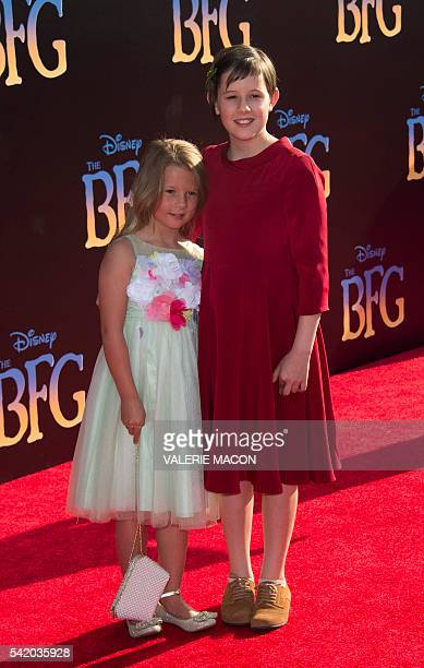 Actress Ruby Barnhill and her sister attend the premiere of Disney's The BFG at El Capitan in Hollywood California June 21 2016 / AFP / VALERIE MACON