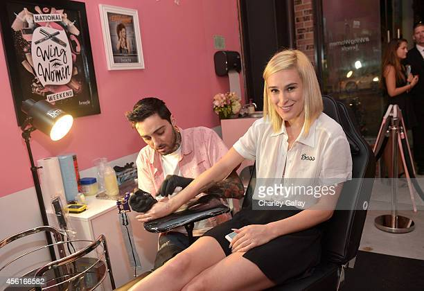 Actress Rumer Willis gets tattooed by artist Romeo Lacoste during Benefit Cosmetics and Vanessa Hudgens KickOff National Wing Women Weekend at Space...