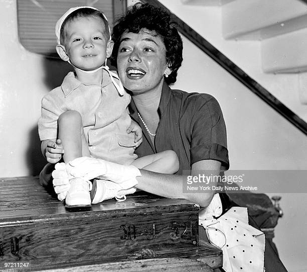 Actress Ruth Roman and her son Richard get an eyeful of the scenery as they arrive aboard the Italian liner Andrea Doria at Pier 84 Ruth wife of...