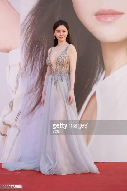 Actress Sabrina Qiu Yinong poses on the red carpet of the 38th Hong Kong Film Awards Ceremony at the Hong Kong Cultural Centre on April 14 2019 in...